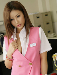 Hot naked asian secretary playfully pulls her panties aside