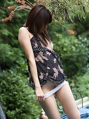 Beautiful Asian teen enjoys showing off her wild side in the outdoors