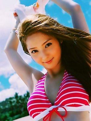Beautiful asian idol looks incredible in a bright pink bikini