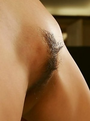 Sugayama Karen hot flexible model strips showing off her big tits and hairy cunt