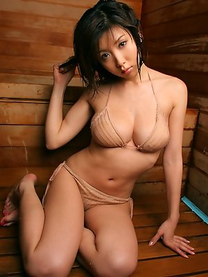 Smoking hot asian babe looks incredible in her skimpy red bikini