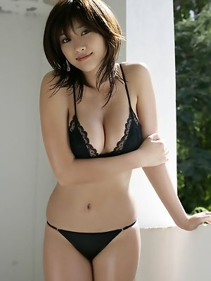 Mikie Hara showing off her plump delicious boobs in a bikini