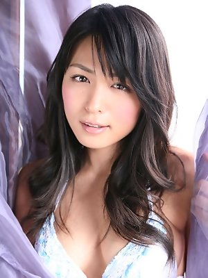 Gravure idol looks incredible in her little dress and bikini